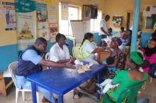 Mothers bring their infants for for RI at Dutse Alhaji PHC, Abuja