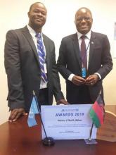 Dr Charles Mwansambo on the right displays the award after it was accepted by the Malawi Minister of Health at UN building conference