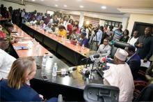 Cross section of dignitaries and journalists at the Press conference