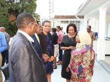 Meeting participants conversing with the Permanent Secretary and WHO Representative