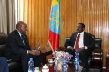 Dr Boureima Hama Sambo, WHO Representative to Ethiopia, discussing with the Ethiopian State Minister of the Ministry of Foreign Affairs, His Excellency Dr Markos Tekle.