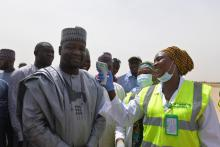 Deputy Governor Usman Kadafur being screened for temperature by Port Health services at the Maiduguri International Airport_Photo_WHO_C.Onuekwe