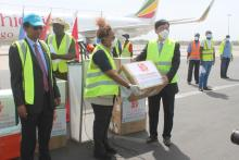 The Chinese Ambassador handing donated materials on behalf of donors to WFP Represntative Madame Wanja Kaaria
