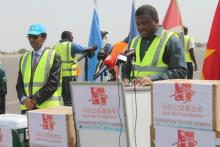 Hon. Dr. Ahmadou Samateh making an official statement after receiving the donated items for COVID-19