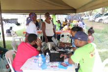 Registering people for TB treatment in one of the community drives