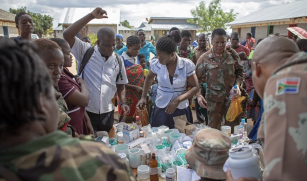 South African army and Malawi Defence Force personnel dispensing medicine.